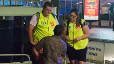 Take Kare ambassadors offer help to a member of the public.