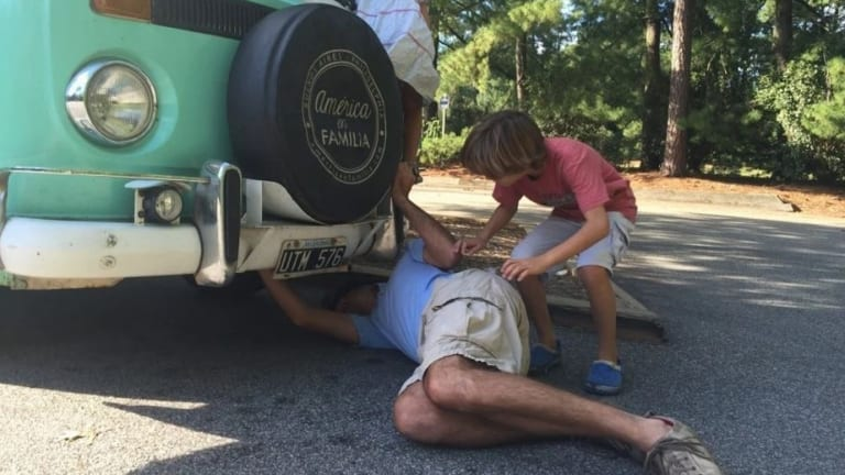 Catire Walker adjusts a valve under Fransisca the kombi van during a stop in North Carolina, part of the routine maintenance that kept the van moving since the family set off in Argentina in March.