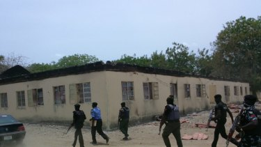 Security forces at the government school three days after gunmen abducted nearly 300 girls