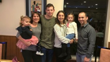 Joel and Angela Hudson of New Lambton with their children.