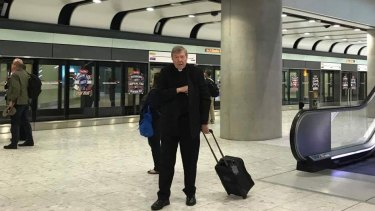 Cardinal George Pell at Heathrow on Friday after flying business class from Rome.