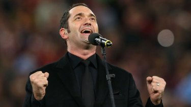 Darren Percival performs the national anthem during game three of the 2012 State of Origin series.