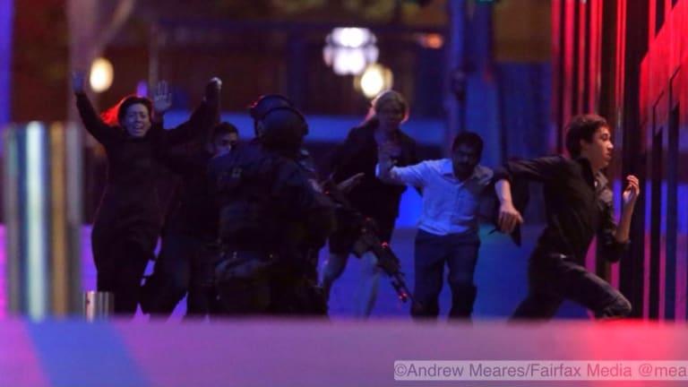 Hostages flee the Lindt cafe