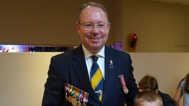 This photo from Hugh McDermott's Facebook page shows him wearing the Australian Individual Readiness Notice (AIRN) badge on Anzac Day last year. The badge is just above the medal he's wearing on the left breast pocket of his suit.