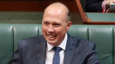 Immigration Minister Peter Dutton has been accused of using the language of a bully.