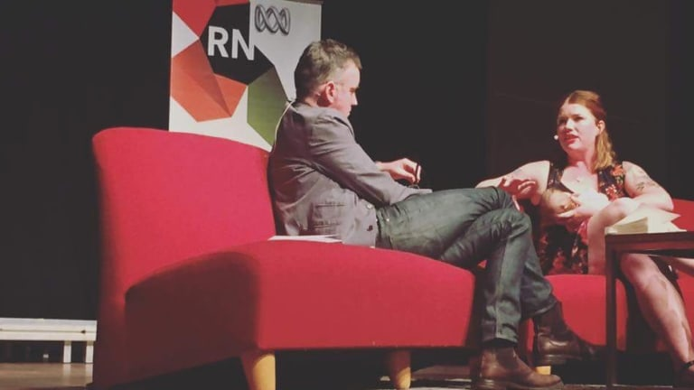 Clementine Ford breastfeeding onstage while speaking to Radio National's Big Ideas.