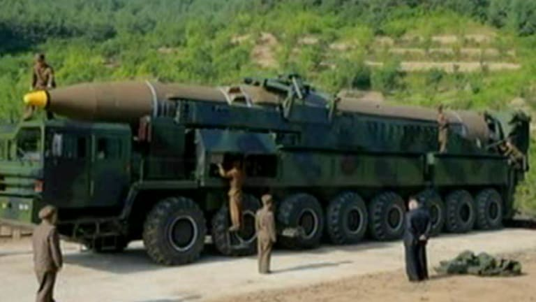 A picture from North Korean media which purports to show the intercontinental ballistic missile launched on July 4, 2017. Kim Jong-un is apparently standing on the right, in a dark suit.