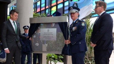 Premier Mike Baird, Police Commissioner Andrew Scipione and Police Minister Troy Grant unveil the plaque for the Curtis Cheng Centre