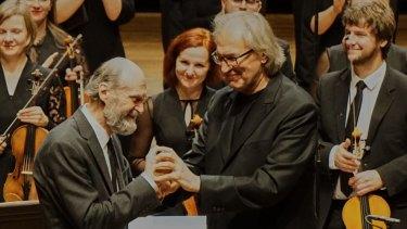 Arvo Part (left) on stage with conductor Tonu Kaljuste.