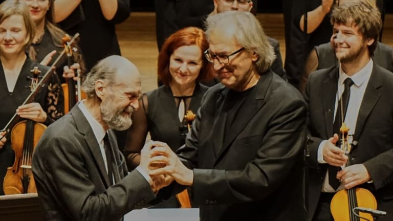Arvo Part (left) on stage with conductor Tonu Kaljuste.