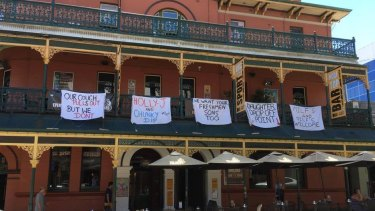 Some of the offensive banners which have forced the Brass Monkey Hotel into issuing an apology.