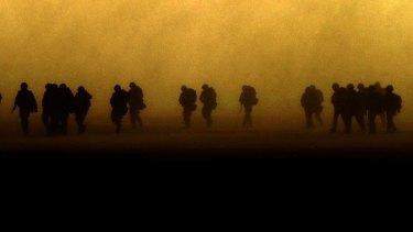 Royal Irish Rangers move towards Iraq in the Kuwaiti desert.