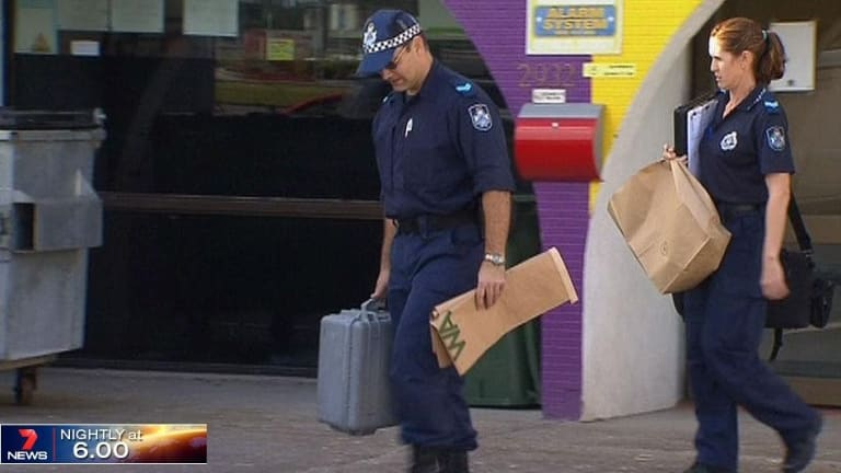 Police seize items during a raid on an Islamic store in Logan, south of Brisbane.