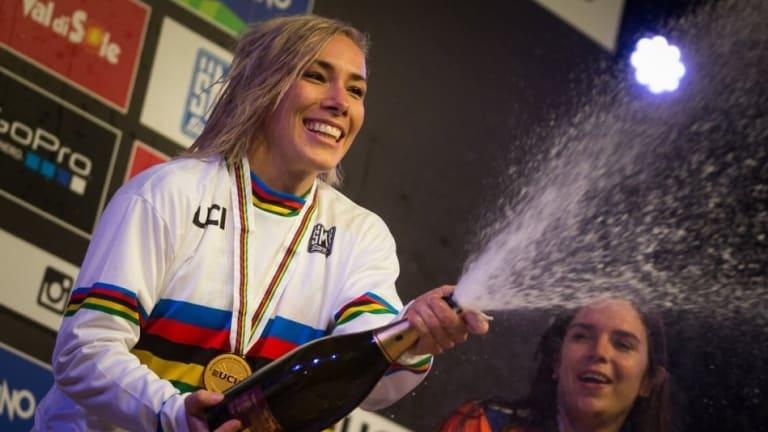 Caroline Buchanan celebrates her mountain bike world title in Italy.