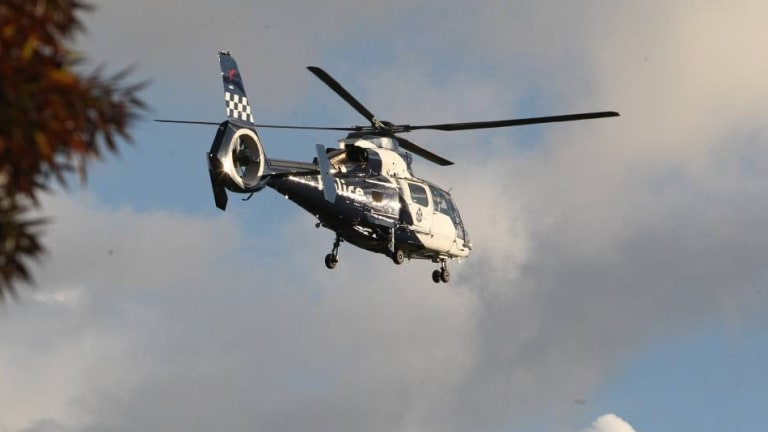 A police helicopter hovers above Wangaratta on Tuesday.