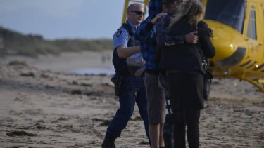 Distraught witnesses at the scene of the attack near Mandurah.