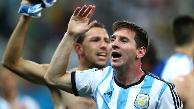 Heading to the final: Lionel Messi celebrates.