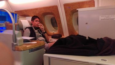 Omar Mohamad enjoying a complimentary champagne before being escorted from a flight bound for the US.