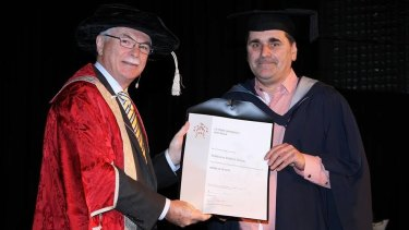 Matte Dunn with Dr Phil Moors, graduating from La Trobe University with a Bachelor of Arts in May 2015.