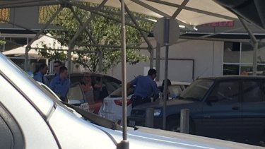 Police work to free a baby left inside a car at Ellenbrook shops.