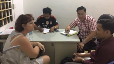 Australian nurse Tammy Davis-Charles is questioned by Cambodian police in November of last year.