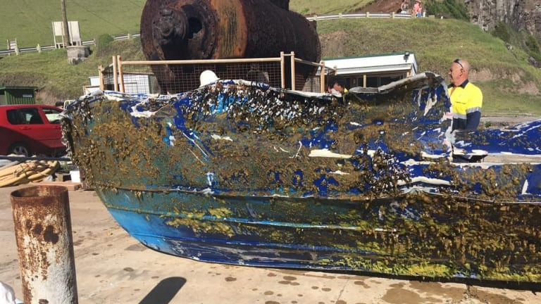 The battered hull of the fishing vessel.