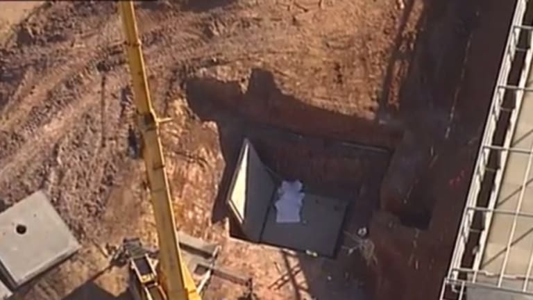 Two men were killed after the concrete slab fell.