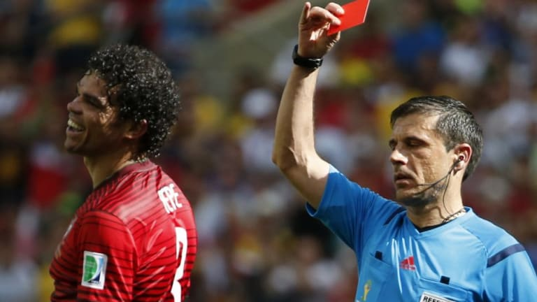 Portugal's Pepe is shown the red card by referee Milorad Mazic