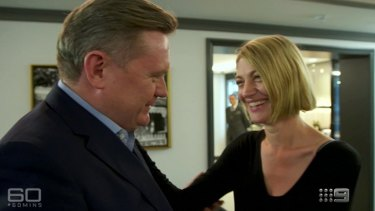 Michael Usher greets colleague Tara Brown at the beginning of a 60 Minutes interview on Lebanon.