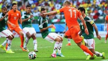 Fouled: Dutch striker Arjen Robben is tripped by Rafael Marquez of Mexico.