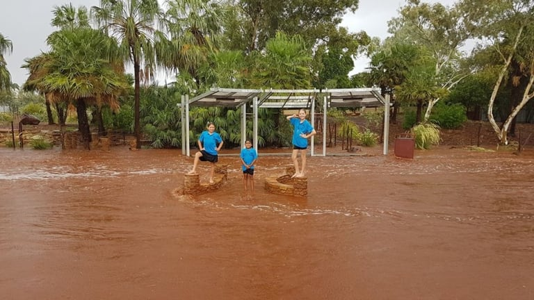 Students making the most of the flood waters.