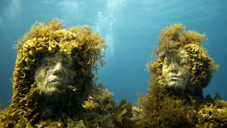 Two of Jason deCaires Taylor's underwater sculptures.