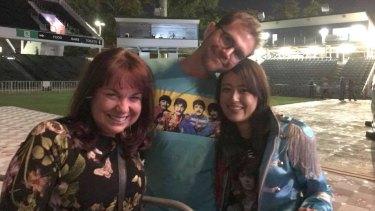 Peth celebrant Kylee Payne with happy couple Marty Davison and Saya Imai, who got engaged at Paul McCartney's Perth concert.