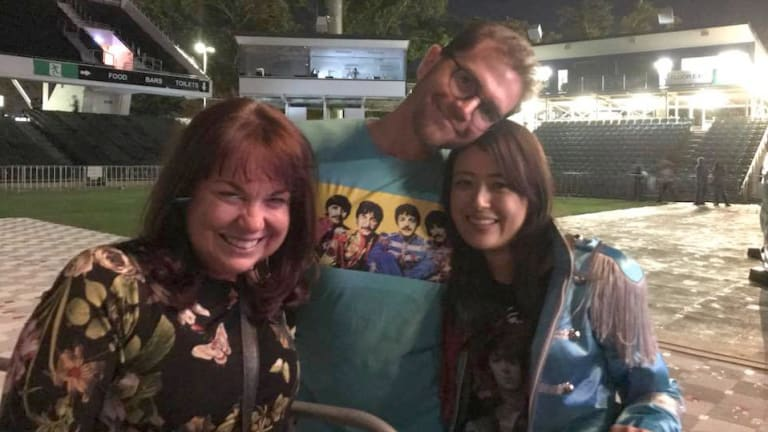 Peth celebrant Kylee Payne with happy couple Marty Davison and Saya Imai, who got engaged at Paul McCartney's Perth concert.