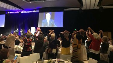 Human Rights Awards finalists joined together in silent protest as Attorney-General George Brandis spoke at the Westin Hotel ceremony.