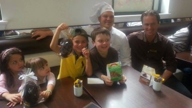 Children (from left) Paige Rowney, Kate Hinchcliff, Henry Hinchcliff and Zachary Rowney with a Lindt chef and manager Tori Johnson.