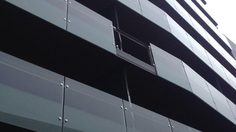 Missing glass following a balcony collapse in central Melbourne.