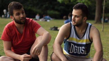 Mohammad Alhajali (left) with his brother Omar who survived the deadly blaze.