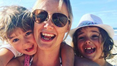 Cat Rodie with her children. She has managed to shield them from the public discussion on same-sex marriage but has plans for tackling the topic if it comes up.