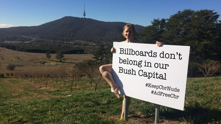 Deb Cleland poses in a cheeky social media campaign hoping to keep Canberra 'nude' - billboard-free.