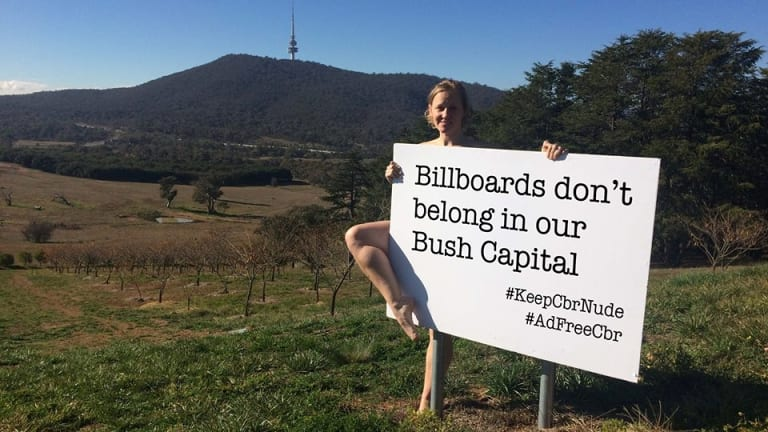 """Deb Cleland poses for a campaign hoping to keep Canberra """"nude"""", or billboard-free."""