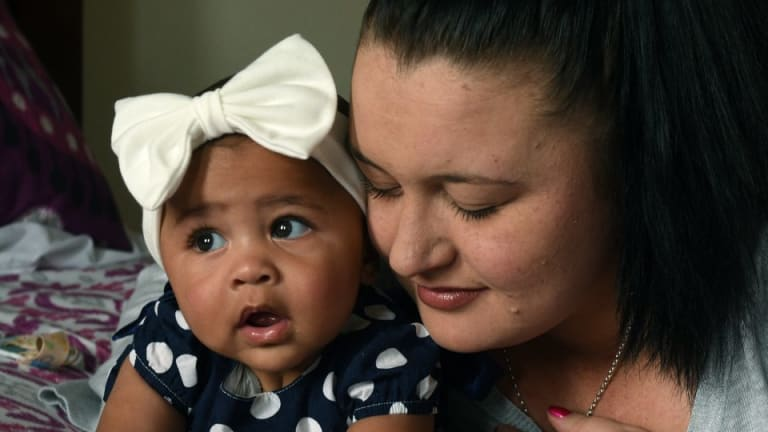Kailah Longbottom with her daughter Elizabeth in their new home.