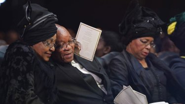 Winnie Mandela hugs then South African president Jacob Zuma after his speech during the funeral service for her former husband Nelson.