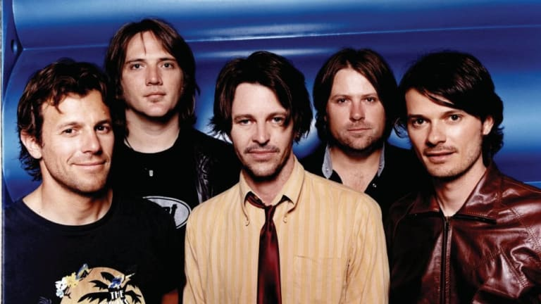 Powderfinger in 2004: (left to right) Jon Coghill, Ian Haug, Bernard Fanning, John ''JC'' Collins and Darren Middleton.