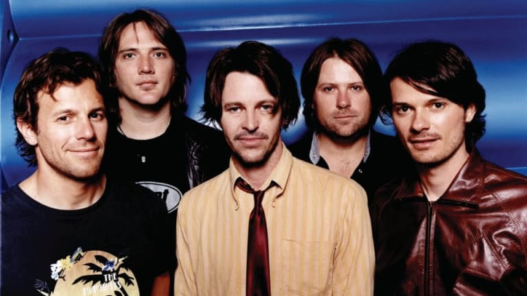 Darren Middleton, far right, with Powderfinger in 2004.