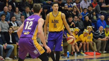 Rising star back home: Australian forward Ben Simmons takes the ball up for LSU against Sydney Kings centre Angus Brandt.