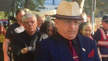 Nathan Sykes (front) and chairman of the Australia First party, Jim Saleam (behind) attending Melbourne Magistrates Court in March, 2017, to support Christopher Shortis, who faced charges over a mock beheading to protest against the Bendigo mosque.