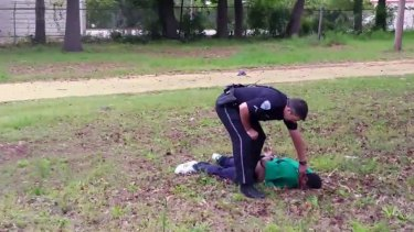 North Charleston police officer Michael Slager is seen standing over 50-year-old Walter Scott after allegedly shooting him in the back.