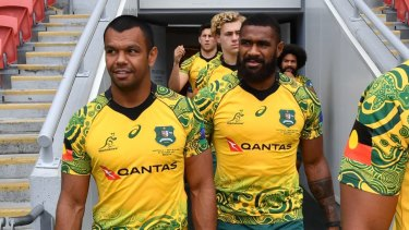 Aboriginal pride: Kurtley Beale models the Indigenous jersey before the captain's run at Suncorp Stadium.