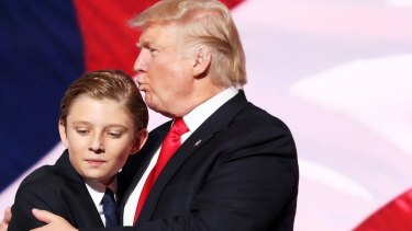Donald Trump embraces his son Barron Trump after he delivered his speech on the fourth day of the Republican National Convention in July 2016.